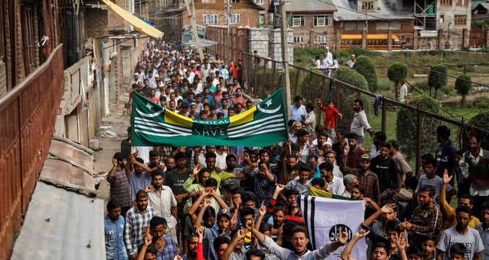 Kashmiri men shout slogans during a protest after the scrapping of the special constitutional status for Kashmir by the Indian government, in Srinagar, August 11, 2019