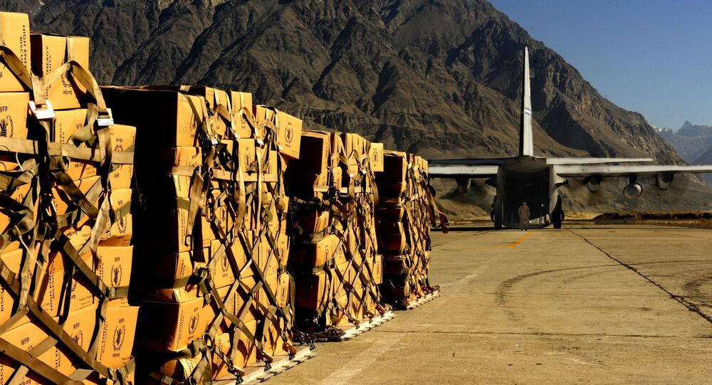 A C-130 Hercules from the 302nd Airlift Wing, Peterson Air Force Base, Colo., prepares for takeoff at the Skardu Airport in Pakistan