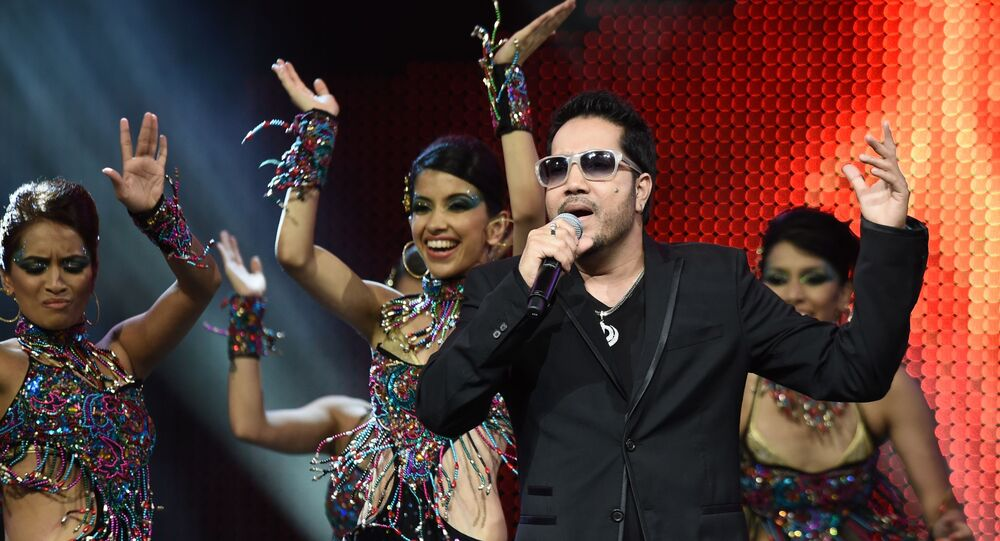 Bollywood singer Mika Singh performs on stage at the Mid Florida Credit Union Amphitheater during the IIFA Magic of the Movies show on the third day of the 15th International Indian Film Academy (IIFA) Awards in Tampa, Florida, April 25, 2014