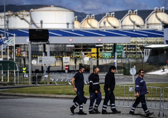 Fuel-tanker drivers leave their trucks to join picketers during the first day of a fuel truck drivers strike at CLC (Fuel Logistics Company) in Aveiras de Cima on August 12, 2019