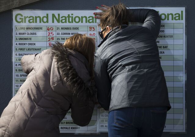 A bookmakers odds board is filled out before the Grand National horse race at Aintree Racecourse Liverpool, England, Saturday, April 11, 2015