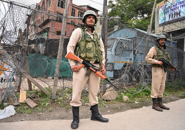 Indian paramilitary troopers stand guard in Srinagar on June 12, 2019, following an attack to a Central Reserve Police Force (CRPF) patrol were at least two Central CRPF personnel were killed during the suspected militant attack in south Kashmir's Anantnag district along the KP road