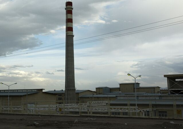 In this picture taken  April 9, 2009  the  exterior view of Iran's Uranium Conversion Facility  outside the city of Isfahan, 255 miles (410 kilometers) south of the capital Tehran is photographed. Iran is lagging behind on equipping a bunker with machines enriching uranium to a grade that can be turned quickly to arm nuclear warheads and now says will produce less at the site than originally planned, diplomats tell The Associated Press.  The diplomats said that Iranian officials recently told the International Atomic Energy Agency that half of the approximately 1,000 centrifuges to be installed at the underground Fordow site will churn out uranium enriched to near 20 percent, while the rest will produce low-enriched material at around 3.5 percent.