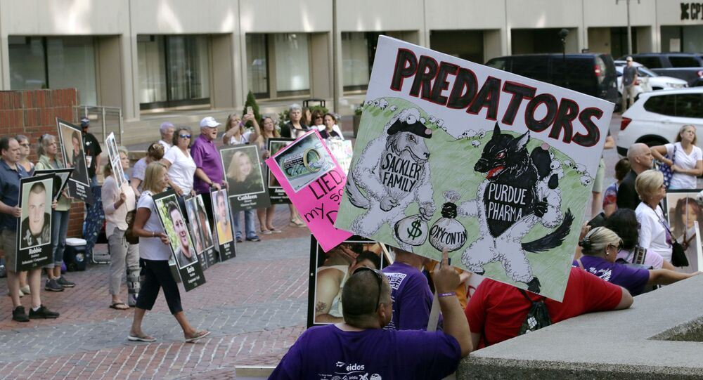 Protesters gather outside a courthouse in Boston on 2 August 2019, where Purdue Pharma faces allegations over the opioid epidemic