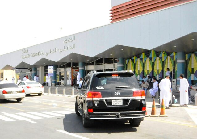 Travellers gather in front of the arrivals lounge at the Abha airport in the southern Saudi Arabian popular mountain resort of the same name, on July 2, 2019. - A Yemeni rebel attack on the civilian airport wounded nine civilians today, a Riyadh-led coalition said, the latest in a series of strikes on the site.