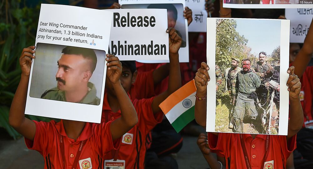 Indian students pray for a speedy release of Indian Air Force pilot Abhinandan Varthaman, in a school in Ahmedabad on February 28, 2019