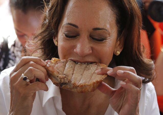 Democratic presidential candidate Sen. Kamala Harris, D-Calif., eats pork at the Iowa State Fair, Saturday, Aug. 10, 2019, in Des Moines, Iowa.