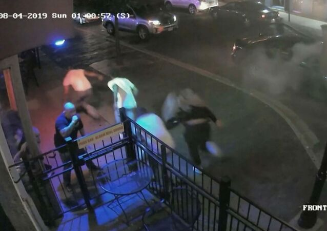 People run during a mass shooting by suspect Connor Betts in a still image from surveillance video released by police in Dayton, Ohio, U.S. August 4, 2019. Dayton Police Department/Handout via REUTERS. THIS IMAGE HAS BEEN SUPPLIED BY A THIRD PARTY.