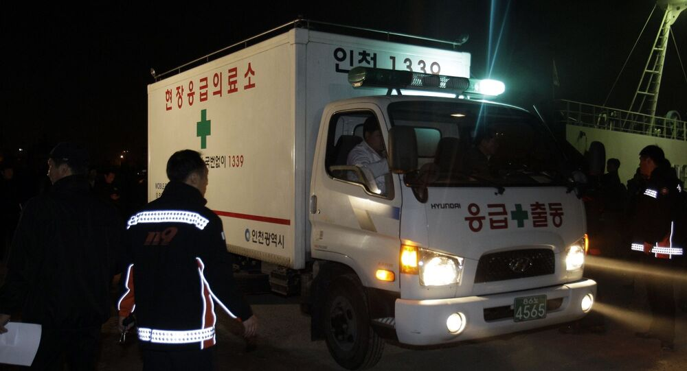 South Korean firefighters and ambulance get on a boat heading to Yeonpyeong Island, at a port in Incheon, west of Seoul, South Korea