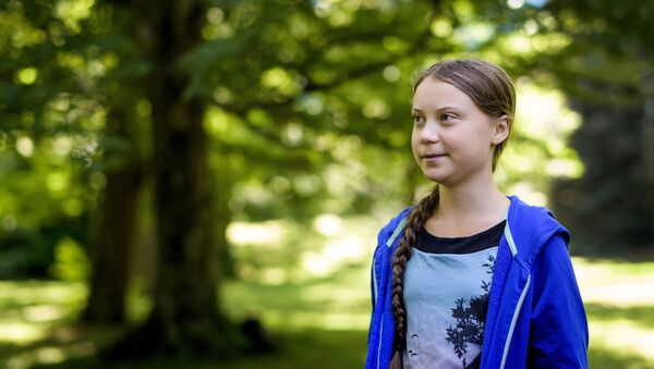 Swedish youth climate activist Greta Thunberg looks on during a meeting with Intergovernmental Panel on Climate Change (IPCC) representatives after the launch of a special IPCC report on climate change and land on August 8, 2019 in Geneva - Sputnik International