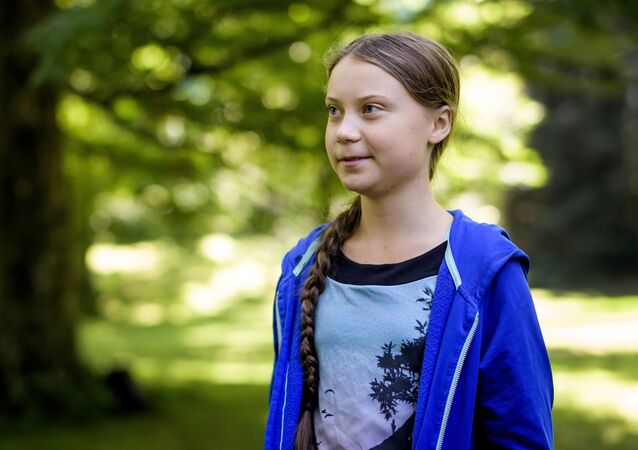 Swedish youth climate activist Greta Thunberg looks on during a meeting with Intergovernmental Panel on Climate Change (IPCC) representatives after the launch of a special IPCC report on climate change and land on August 8, 2019 in Geneva