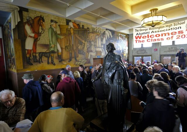 In this Aug. 1, 2019, file photo, people fill the main entryway of George Washington High School to view the controversial 13-panel, 1,600-square foot mural, the Life of Washington, during an open house for the public in San Francisco.