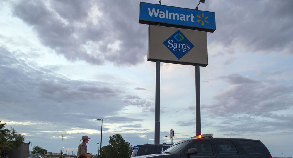 FILE - In this Aug. 4, 2019, file photo a Texas State Trooper walks back to his car while providing security outside the Walmart store in the aftermath of a mass shooting in El Paso, Texas.  Like most retailers, Walmart is accustomed to the everyday dealings of shoplifters. Now, it's confronting a bigger threat: active shooters. Days after a man opened fire at one of its stores in El Paso and left several dead, the nation's largest retailer is faced with how to make its workers and customers feel safe.