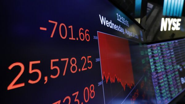 A screen above the trading floor shows an intraday number for the Dow Jones industrial average, at the New York Stock Exchange, Wednesday, Aug. 14, 2019. Stocks are falling sharply after the bond market threw up another warning flag on the economy.  - Sputnik International