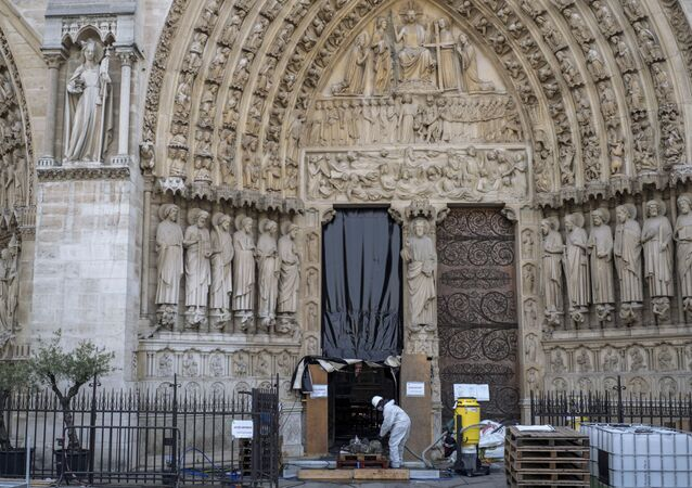 A worker is pictured during preliminary work at the Notre-Dame de Paris Cathedral, in Paris, France July 24, 2019