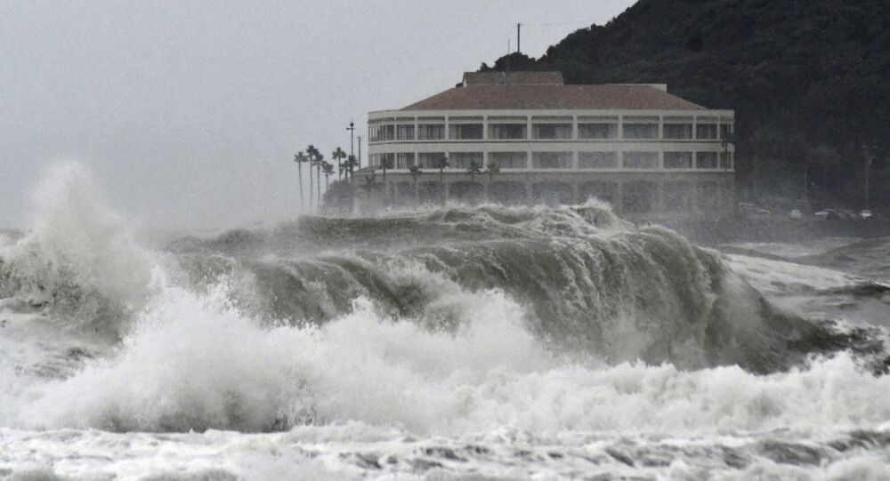 High waves pound a beach in Miyazaki, southwestern Japan as typhoon Krosa approaches the country in this photo taken by Kyodo August 13, 2019.