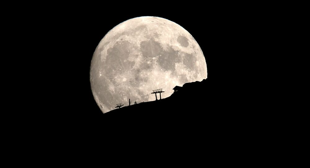 A ski lift at the Kalavrita ski centre on Mount Helmos is silhouetted as the moon rises