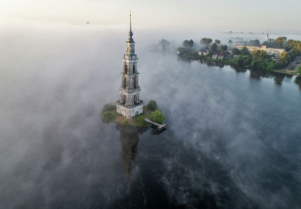 The famous Kalyazin Bell Tower, part of the submerged monastery of St. Nicholas, is seen in the morning fog in the town of Kalyazin