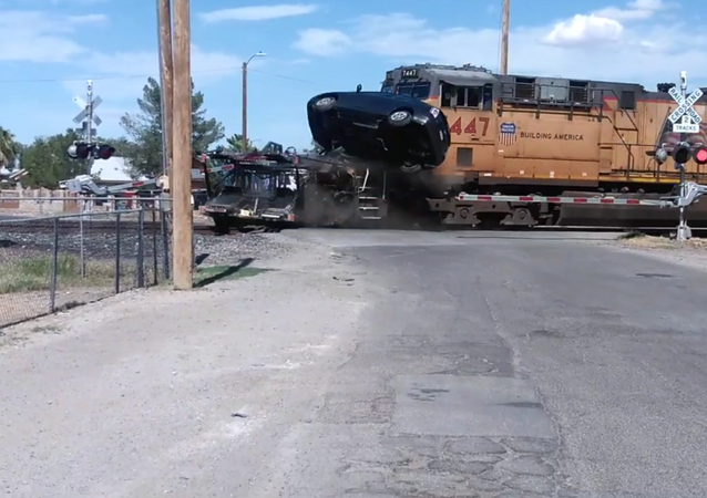 Toyota Prius Goes Flying After Getting Rammed by Cargo Train
