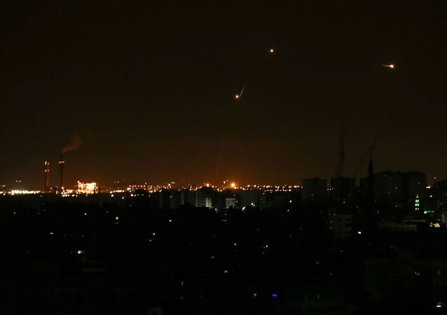 Three missile from the Iron Dome air defence system, designed to intercept and destroy incoming short-range rockets and artillery shells, from a position in the southern Israeli are seen from Gaza city on June 20, 2018.
