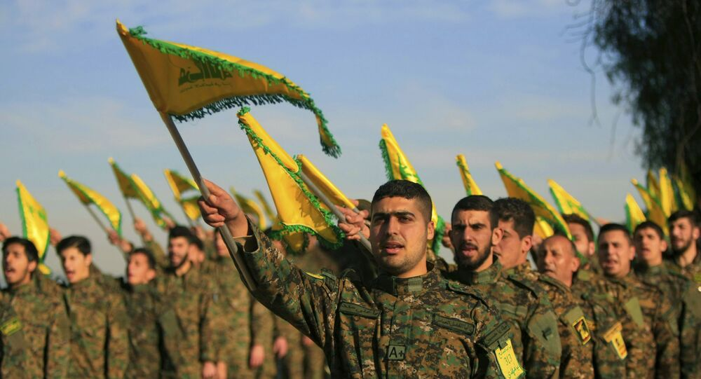 Hezbollah fighters hold flags as they attend the memorial of their slain leader Sheik Abbas al-Mousawi, who was killed by an Israeli airstrike in 1992