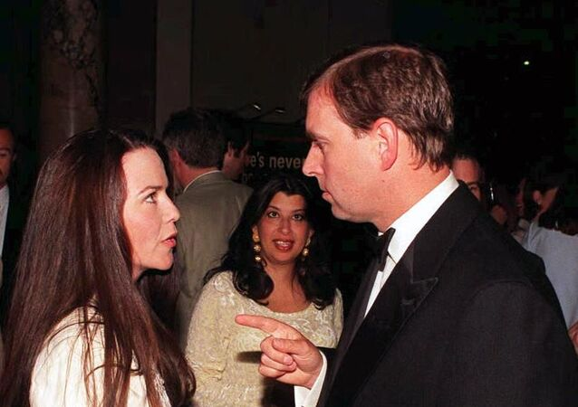 Prince Andrew (R) chats to his old flame, photographer Koo Stark, as they meet during a reception following his official opening of the Canon Photographic Gallery at the Victoria & Albert Museum in London this Tuesday evening, 19 MAY.