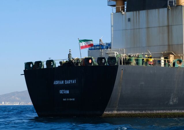 An Iranian flag flutters on board the Adrian Darya oil tanker, formerly known as Grace 1, off the coast of Gibraltar on August 18, 2019. - Gibraltar rejected a US demand to seize the Iranian oil tanker at the centre of a diplomatic dispute as it prepared to leave the British overseas territory after weeks of detention.