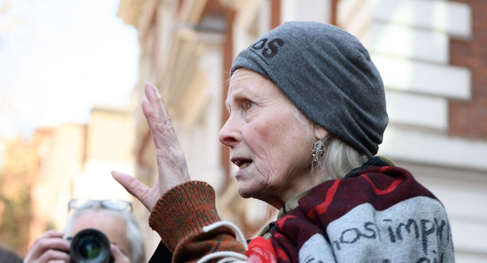 Fashion designer Vivienne Westwood speaks to journalists outside the Westminster Magistrates' Court in London