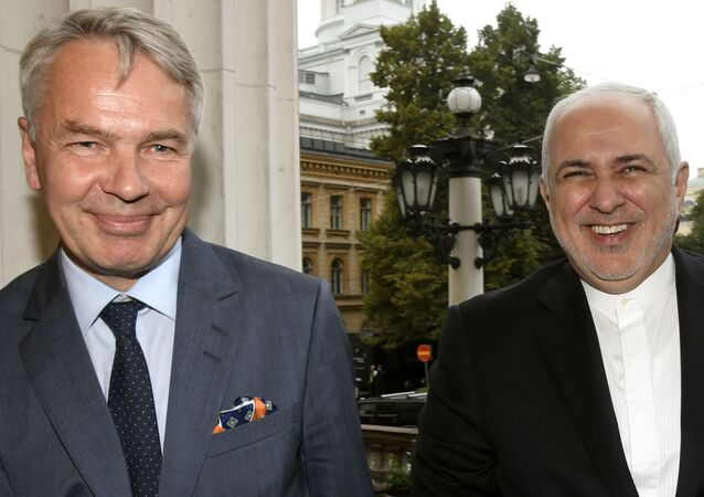 The Foreign Minister of Finland Pekka Haavisto (L) welcomes visiting Foreign Minister of Iran Mohammed Javad Zarif at the House of the Estates in Helsinki, Finland on August 19, 2019.