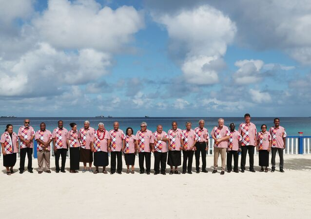 Australia's Prime Minister Scott Morrison (5th R) posing for a group photo with other leaders on the sidelines of the Pacific Islands Forum in Tuvalu