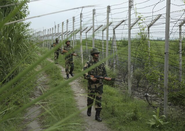 India's Border Security Force (BSF) soldiers patrol near the India-Pakistan border fence at Garkhal in Akhnoor, about 35 kilometers (22 miles) west of Jammu, India, 13 August 2019