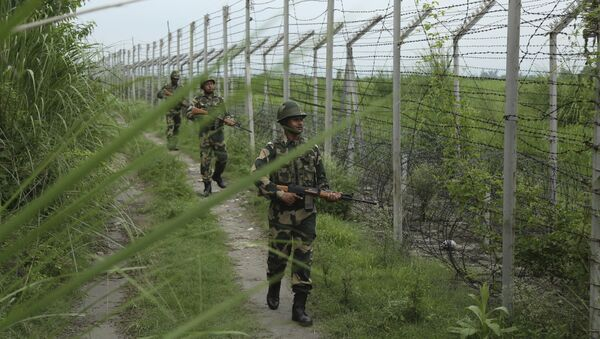 India's Border Security Force (BSF) soldiers patrol near the India Pakistan border fencing at Garkhal in Akhnoor, about 35 kilometers (22 miles) west of Jammu, India, Tuesday, Aug.13, 2019 - Sputnik International