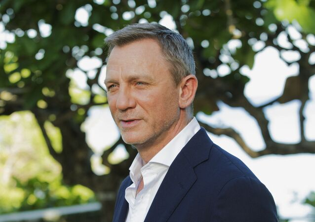 Daniel Craig poses for photographers during the photo call for James Bond film franchise