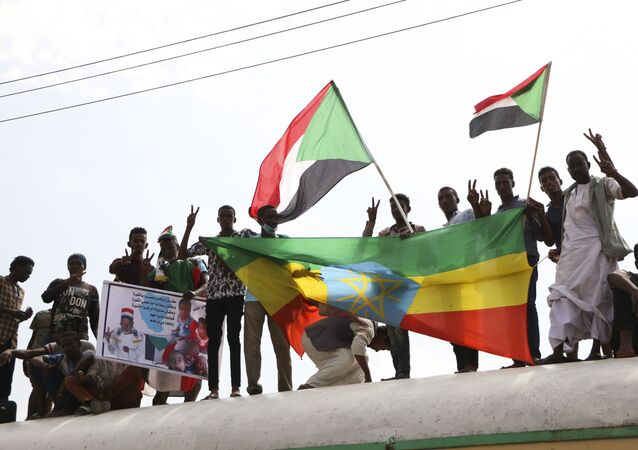 Sudanese protesters celebrate a final power-sharing agreement with the ruling military council Saturday, Aug 17, 2019, in the capital, Khartoum.