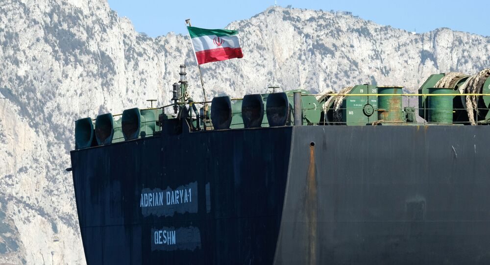 An Iranian flag flutters on board the Adrian Darya oil tanker, formerly known as the Grace 1, off the coast of Gibraltar on 18 August 2019.