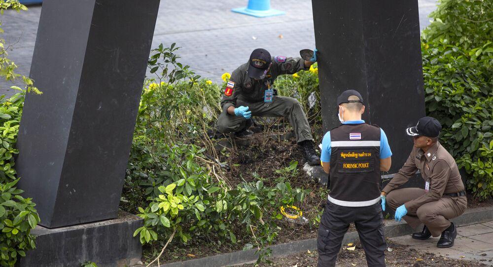 Thai investigators examine a site of an explosion