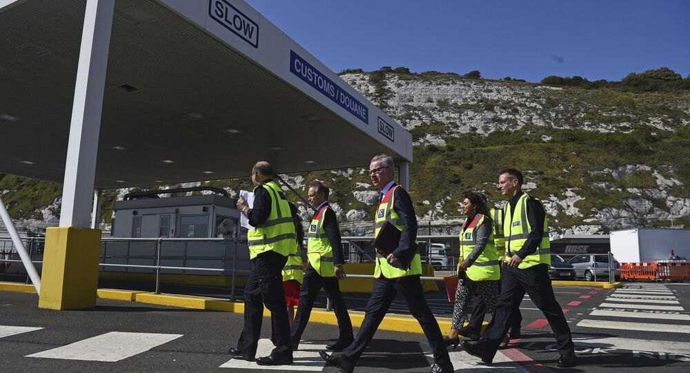 Chancellor of the Duchy of Lancaster Michael Gove, centre and Transport Secretary Grant Shapps walk, during a visit to the Port of Dover for a meeting with port officials about the work they are doing to ensure the UK's smooth exit from the European Union, in Dover, England, Wednesday, Aug.  7, 2019