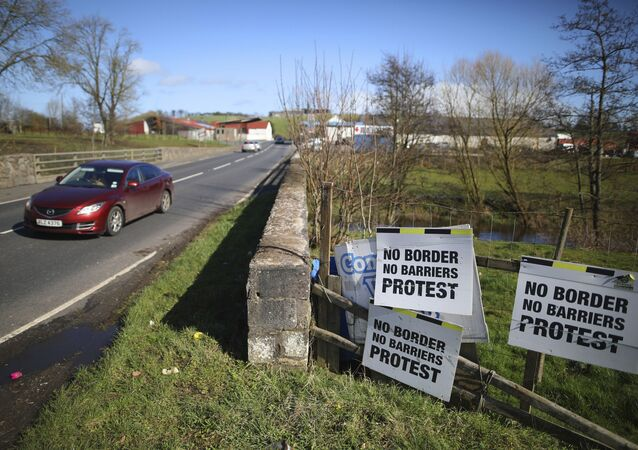 A Motorist crosses the Irish border in Middletown, Northern Ireland, Tuesday, March, 12, 2019. The issue of a possible physical border between the United Kingdom's Northern Ireland and the Republic of Ireland, an EU state, received scant attention during the 2016 Brexit referendum. But it has proven to be a major stumbling block in the British government's quest for a divorce deal.