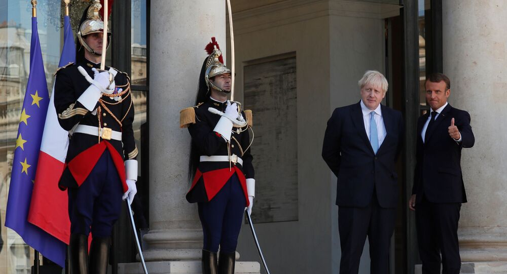 French President Emmanuel Macron reacts next to British Prime Minister Boris Johnson after a joint statement before a meeting on Brexit at the Elysee Palace in Paris, France, August 22, 2019