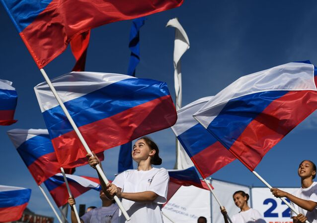 Girls holding Russian flags during celebrations of the National Flag Day in Novosibirsk