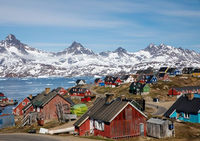 Snow covered mountains rise above the harbour and town of Tasiilaq, Greenland, June 15, 2018.