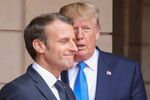 FILE PHOTO: French President Emmanuel Macron speaks with U.S. President Donald Trump on the sidelines of commemorations marking the 75th anniversary of the World War II D-Day landings in Normandy, France,  June 6, 2019