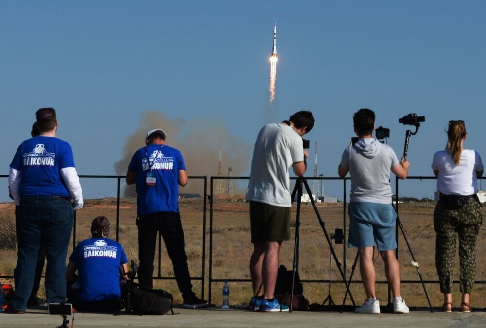 Journalists watch the launch of the Soyuz-2.1a carrier rocket with the piloted Soyuz MS-14 vehicle from the Baikonur spaceport.