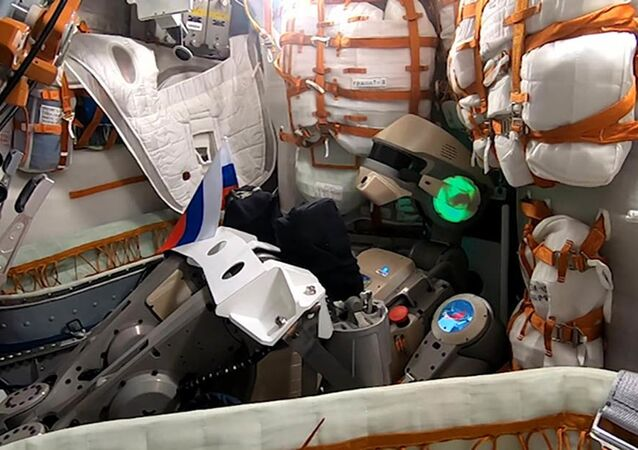 Humanoid robot Skybot F-850 (Fedor) wishes Russians a happy National Flag Day from inside the Soyuz MS-14 spacecraft.