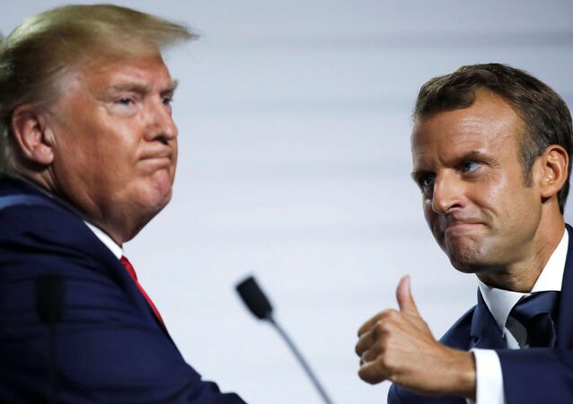 French President Emmanuel Macron and U.S. President Donald Trump react during a news conference at the end of the G7 summit in Biarritz, France