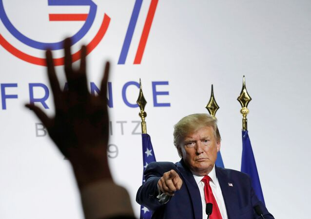 U.S. President Donald Trump gestures during his news conference at the end of the G7 summit in Biarritz, France