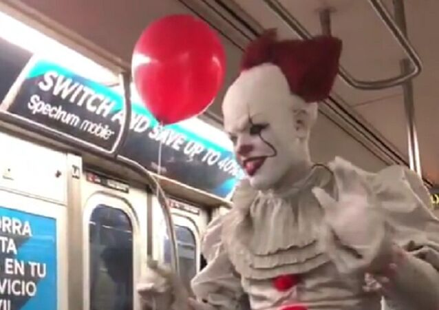 "A magician dressed as Pennywise the clown from the Stephen King horror flick ""It"" strolled through a Manhattan L train"