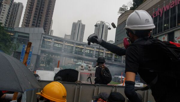 An anti-extradition bill protester throws a stone at police during clashes in Tsuen Wan in Hong Kong, China August 25, 2019. - Sputnik International
