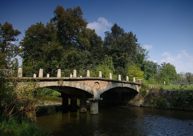 A bridge over the river Lambro in Monza Park, Monza, Italy