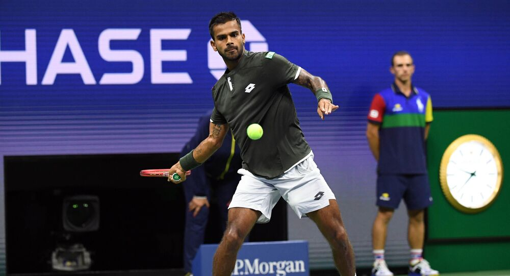 Aug 26, 2019; Flushing, NY, USA; Sumit Nagal of India hits to Roger Federer of Switzerland in the first round on day one of the 2019 U.S. Open tennis tournament at USTA Billie Jean King National Tennis Center